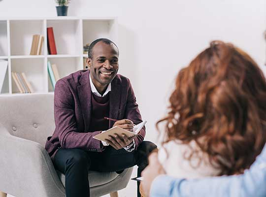 Online psychology degree student practices counselling with a couple.